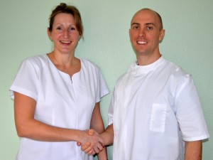 Picture of Karen Robinson welcoming new osteopath, Robert Kraina